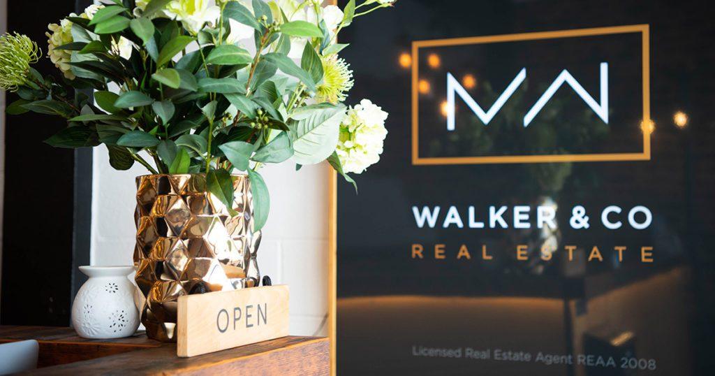 Image: Walker & Co Real Estate logo